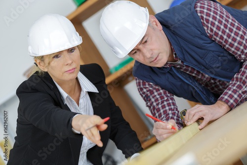 engineer planning architectural project with engineering tools