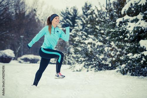 Winter sport, girl exercising in park