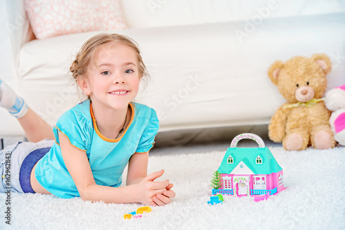 playing with toy house