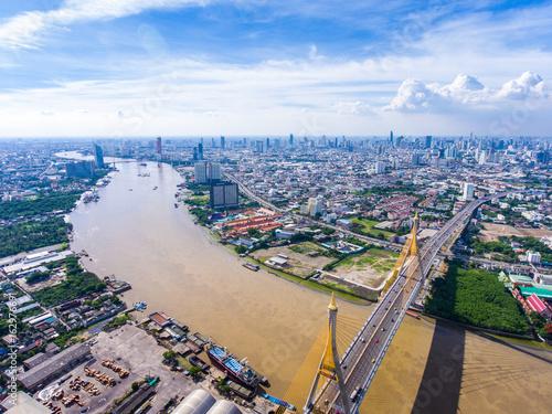 Aerial view of bridge cross river path into city, Bangkok Photo by komjomo