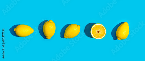 Fresh lemon pattern on a vivid blue background flat lay - 162977096