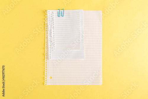 Blank Sheet Of Notebook Paper On A Yellow Background Buy Photos