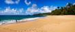Boy playing at Secret Beach (Kauapea), Kauai, Hawaii