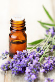 Lavender essential oil in the amber bottle, with fresh lavender flower heads. - 162982649