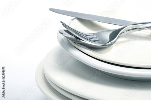 close up dinning  silverware fork , spoon and knife with dish on white background and text space