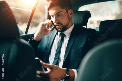 Young business working during travelling to office