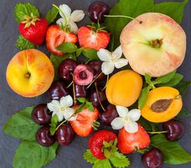 Summer fresh sliced fruits on slate. Love for a healthy vegan food concept.