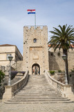 The Revelin Tower,  entrance to the old town on Korkula, Croatia. The carved text says