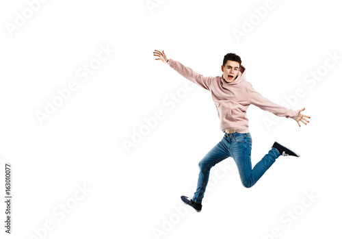 Young man jumping on white background Poster