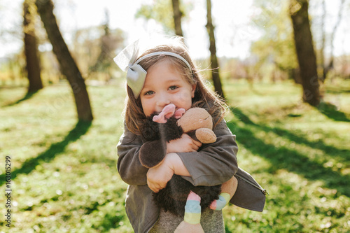 Charming little girl posing with toy