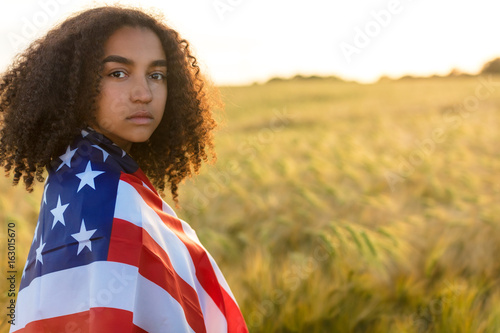 Sad Mixed Race African American Girl Teenager With USA Flag Field at Sunset
