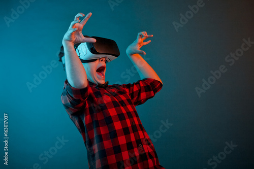Scared boy in VR headset