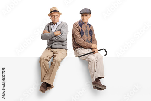 Angry seniors sitting on a panel