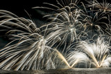 Details of fireworks show on the lake in a summer night - 163019208