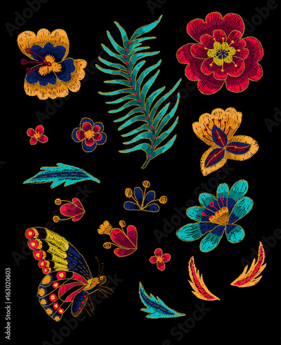 Butterfly with flowers vector embroidery elements. - 163020603
