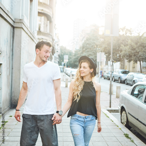 Young couple walking down the street