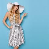 Summer Woman In White Sun Hat Is Smiling And Pointing - 163026664