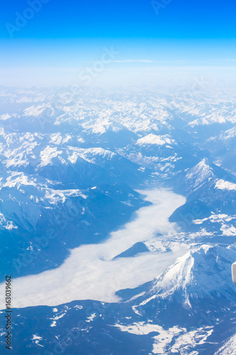 Snow Alps - aerial view from window of airplane Poster