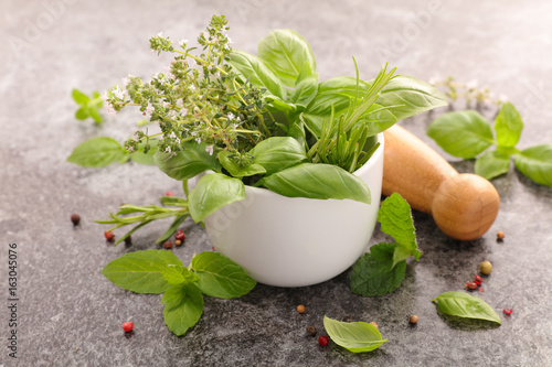 mixed herbs in mortar