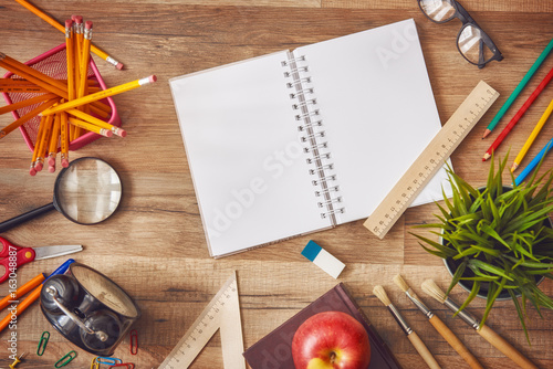 Wooden desk with supplies