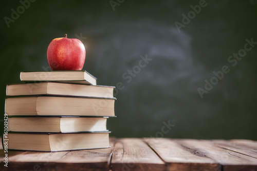 Apple and pile of books