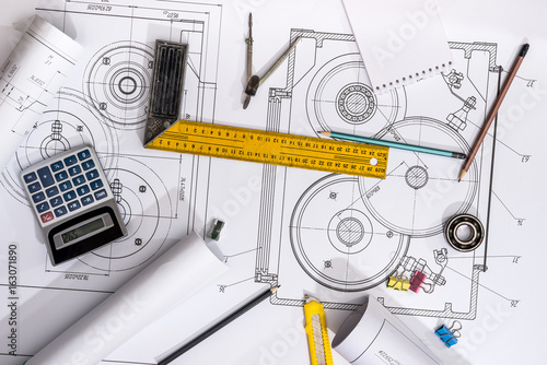 measuring tools on the background of technical drawings. view on top