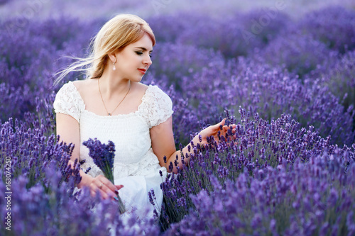woman sitting at lavender field