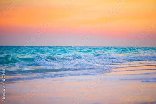 Amazing beautiful sunset on an exotic caribbean seashore
