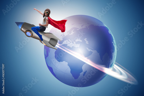 Little girl flying rocket in superhero concept - 163077097