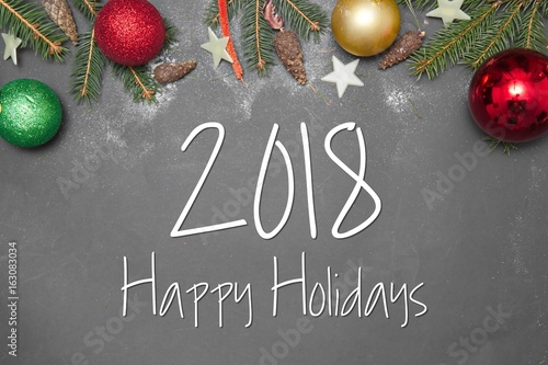 Christmas Decoration  with text HAPPY HOLIDAYS  on gray background