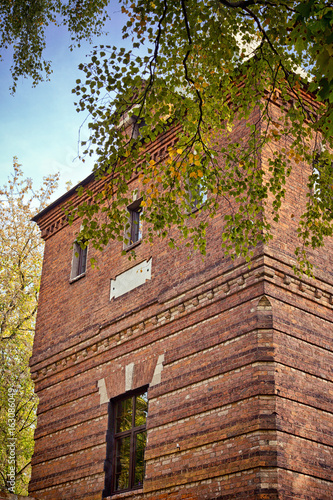 An old brick building. Architectural monument. Water tower of the 19th century.