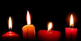 Burning candles on black background - 163089635