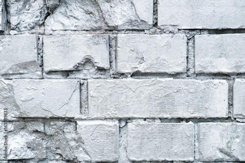 silver painted brick wall - graffiti background