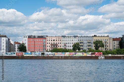 River Spree, graffiti wall and apartment buildings in Berlin, Friedrichshain