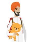 Hindu traveler man holding teddy bear.