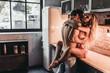 Leinwanddruck Bild - Couple on kitchen