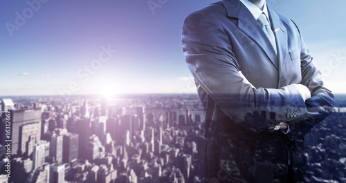 Businessman in front of a big city