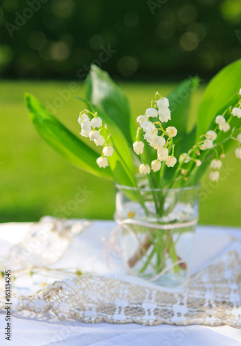 Lily of the valley bouquet in glas vase.