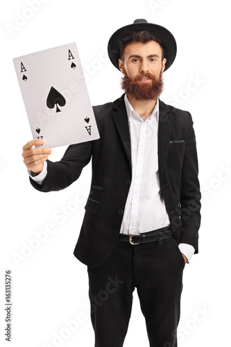 Bearded man showing an ace of spades card