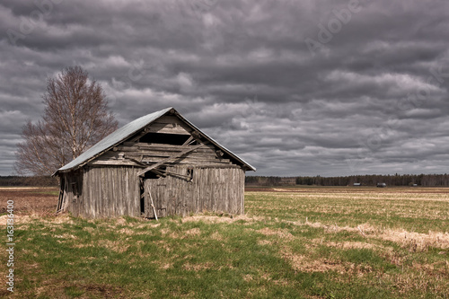 Rain Clouds Over The Old Barn House