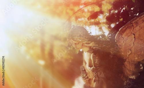 golden angel in the sunlight (antique statue) - 163143274