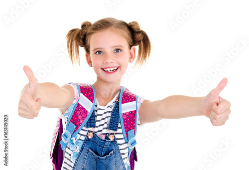 Portrait of smiling happy school girl child with school bag and two fingers up