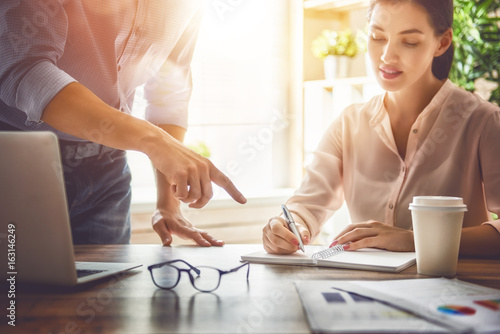 man and woman working in the office