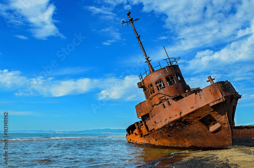An old broken rusty ship