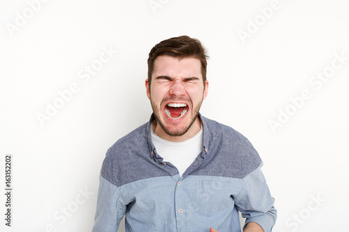 Portrait of angry crying man, isolated