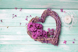 Violet lilac flowers, decorative heart and lantern on turquoise wooden background. - 163152858