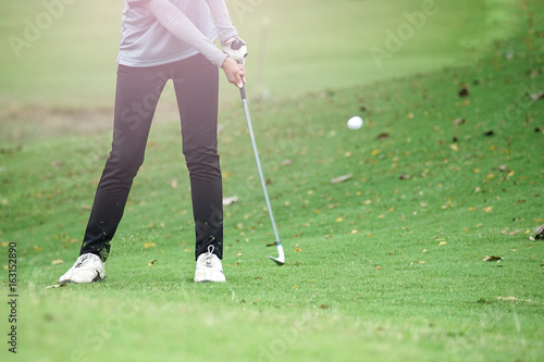 Woman golf is a sport requiring heat tolerance.