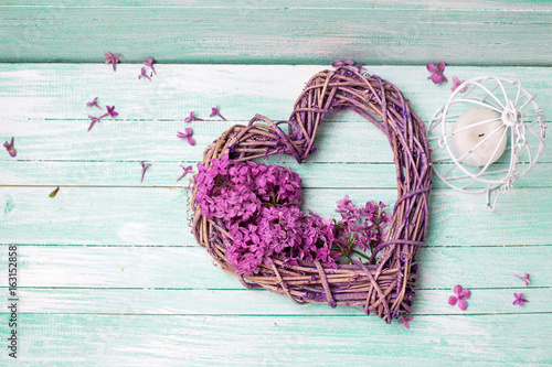 Violet lilac flowers, decorative heart and lantern on turquoise wooden background Plakat
