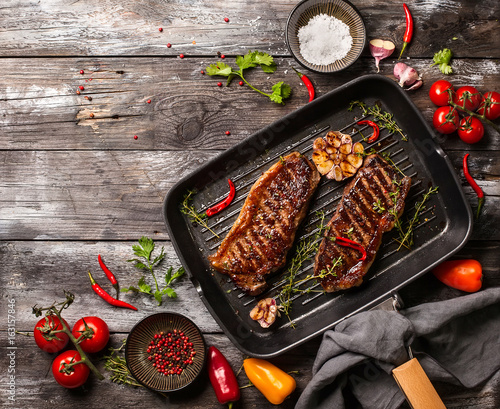 Grilled  strip steak with spices - 163157846