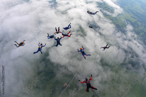 The team of skydivers is in the sky